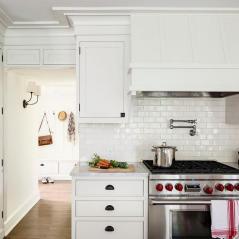 white-glazed-mini-subway-tiles-white-kitchen-cabinets-bronze-cup-pulls