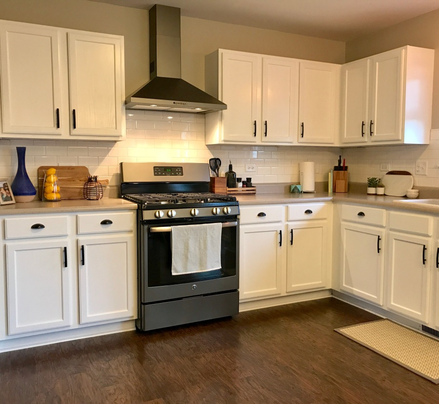 Kitchen Reveal: Gleaming Subway Tile, Dark Slate Appliances, and One Sexy Hood